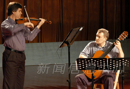 Eric Lawson, violin, and Jeff Anvinson, guitar, performing in China